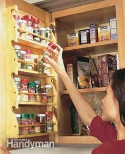 Add a spice rack to an upper cabinet.