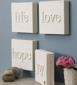 wooden letters glued onto a canvas, then spray-painted all white!