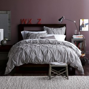 Bedroom: plum wall, gray tufted duvet & shams