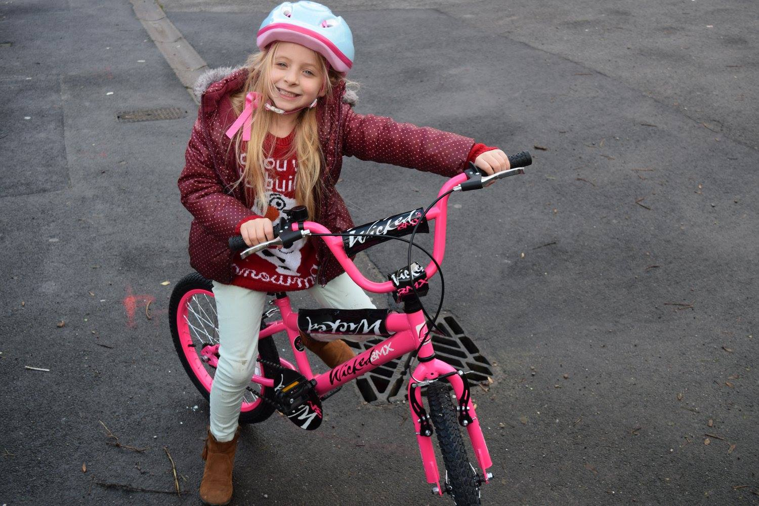 Caitlin posing for a photo on her new bmx bike - Serenity you